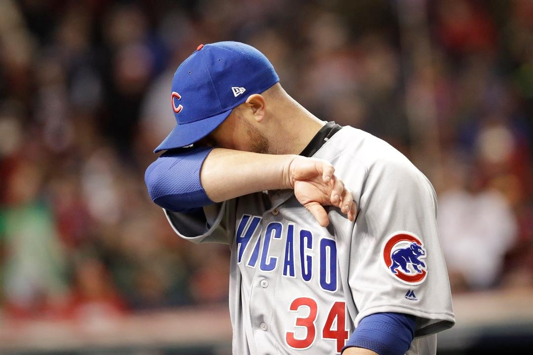 Chicago Cubs' Jon Lester wipes his face as he leaves the game during the sixth inning of Game 1 of the Major League Baseball World Series against the Cleveland Indians Tuesday, Oct. 25, 2016, in Cleveland. (AP Photo/David J. Phillip)