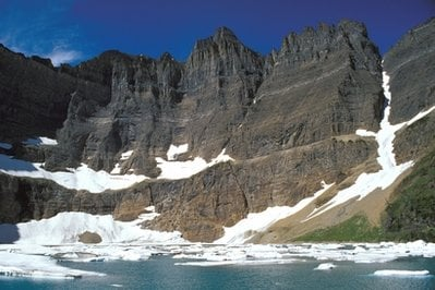 This undated photo provided by the National Park Service shows Iceberg Lake at Glacier National Park, Mt. Scientists on Wednesday, April 7, 2010 said that Glacier National Park has lost two more of its namesake moving icefields to climate change.