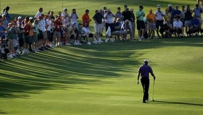 Tiger Woods walks down the second fairway during a practice round for the Masters golf tournament in Augusta, Ga., Wednesday, April 7, 2010. The tournament begins Thursday, April, 8. (AP Photo/David J. Phillip)