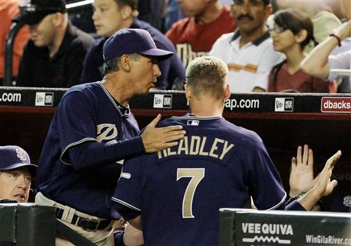San Diego Padres' Chase Headley (7) is congratulated by manager Bud Black after scoring a run on a two-run double by Everth Cabrera during the second inning of a baseball game against the Arizona Diamondbacks, Tuesday, April 6, 2010, in Phoenix.