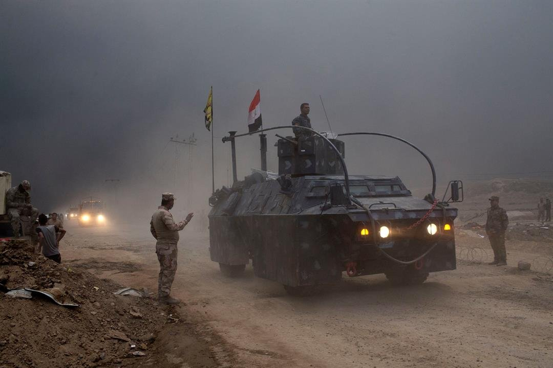 An Iraqi Federal Police vehicle passes through a checkpoint in Qayara, some 50 kilometers south of Mosul, Iraq, Wednesday, Oct. 26, 2016. Islamic State militants have been going door to door in farming communities south of Mosul, ordering people at gunpoi