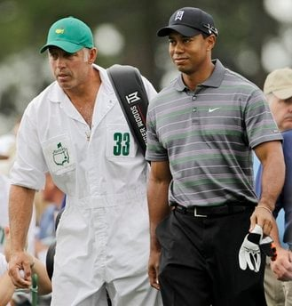 Tiger Woods makes his way to the first tee with caddie Steve Williams during the first round of the Masters golf tournament in Augusta, Ga., Thursday, April 8, 2010. (AP Photo/Morry Gash)