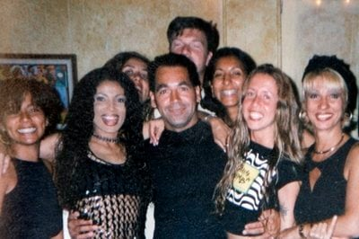 This personal undated photo provided by Mariza Alyrio shows Monica Beresford-Redman, third from right, next to her husband Bruce Beresford-Redman, partly obscured at center rear, made available Thursday, April 8, 2010.