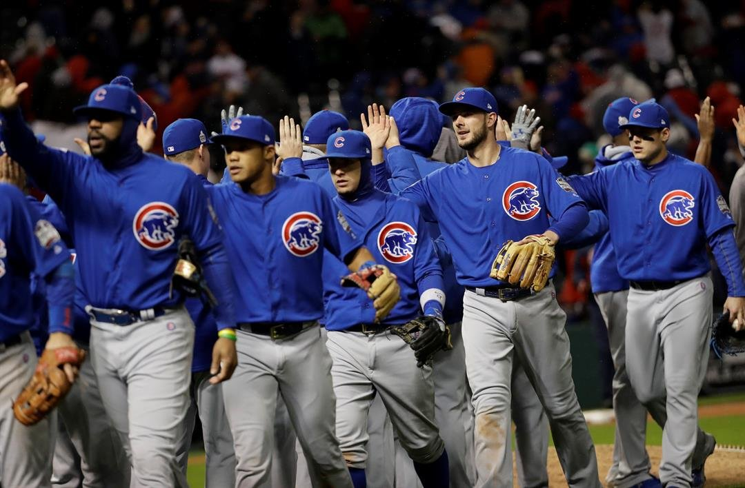 The Chicago Cubs celebrate after Game 2 of the Major League Baseball World Series against the Cleveland Indians Wednesday, Oct. 26, 2016, in Cleveland. The Cubs won 5-1 to tie the series 1-1. (AP Photo/David J. Phillip)