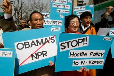 South Korean activists shout slogans during a rally against U.S. President Barack Obama's new nuclear policy near the U.S. Embassy in Seoul, South Korea, Thursday, April 8, 2010.