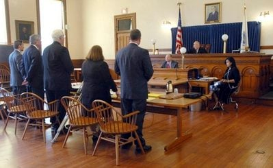 Judge Judd J. Carhart, right, presides IN Hampshire Superior Court over the arraignment of three Massachusetts teenagers, who waived their rights to appear yet pleaded not guilty through their lawyers, left, Tuesday, April 6, 2010, in Northampton, Mass..