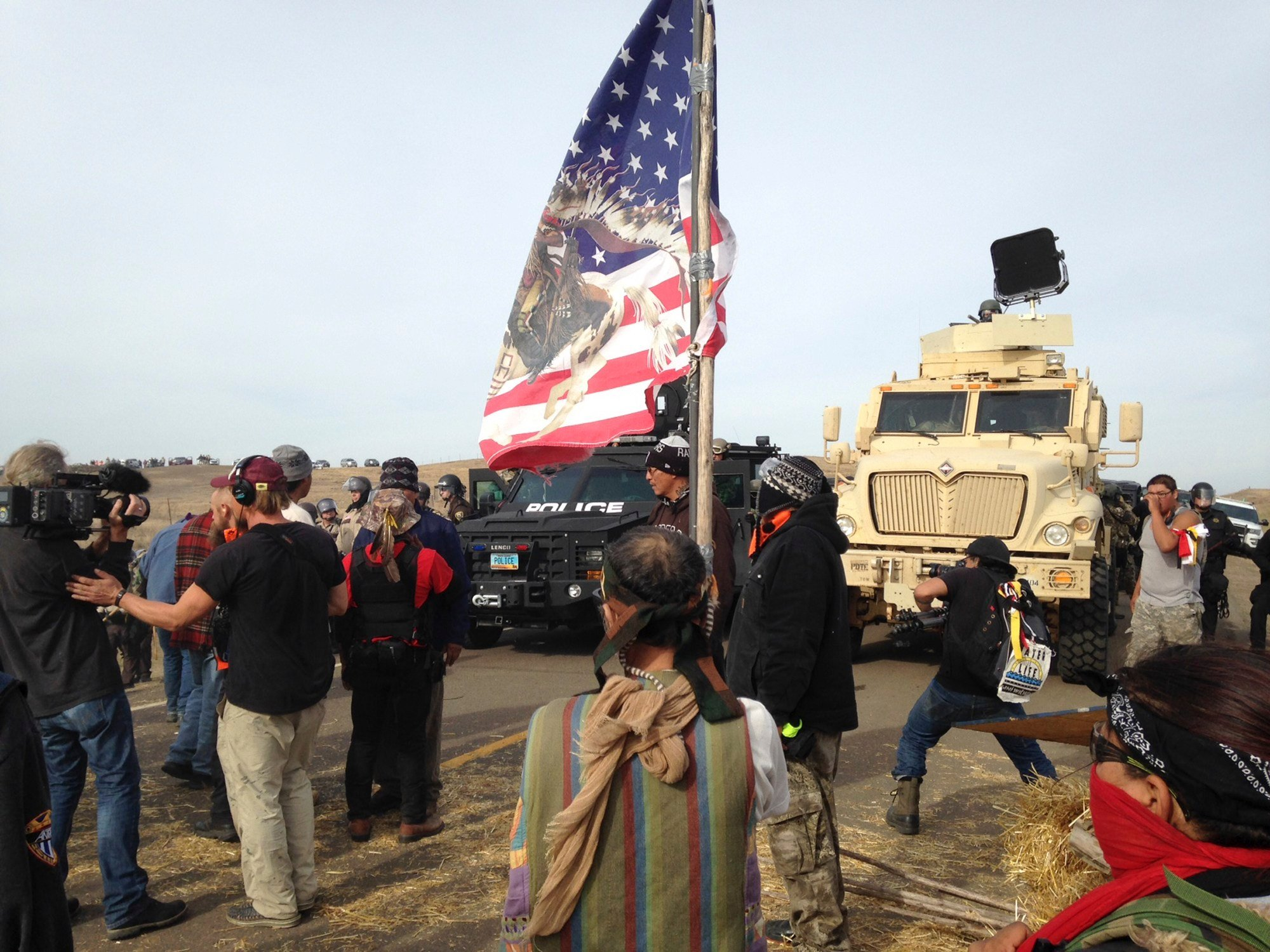 Dakota Access pipeline protesters defy law enforcement officers who are trying to force them from a camp on private land in the path of pipeline construction on Thursday, Oct. 27, 2016, near Cannon Ball, N.D. The months-long dispute over the four-state, $