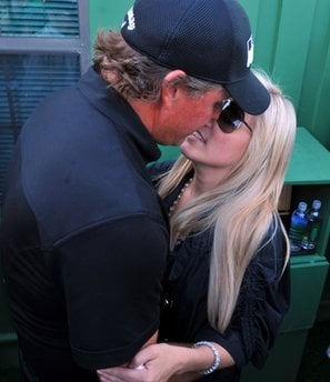 Phil Mickelson kisses his wife Amy after winning the Masters golf tournament in Augusta, Ga., Sunday, April 11, 2010. (AP Photo/The Journal & Constitution, Brandt Sanderlin)