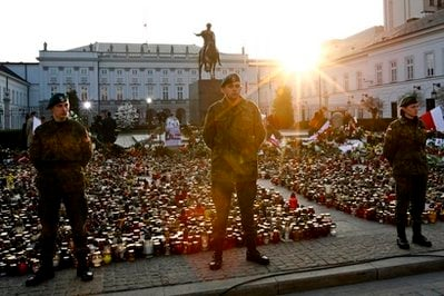 Polish soldiers stand guard near a sea of candles in front of the President Palace two days after Polish President Lech Kaczynski died in a plane crash, in Warsaw, early Monday, April 12, 2010. Kaczynski.