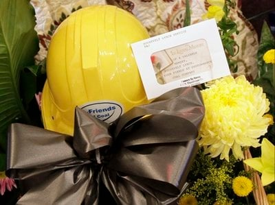 A miner's helmet is placed amid the floral arrangements surrounding the casket of miner William Roosevelt Lynch of Oak Hill, W.Va. during funeral services on Sunday, April 11, 2010.