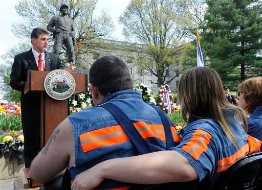 West Virginia Gov. Joe Manchin, at podium, speaks about the 29 miners killed one week ago in an explosion at the Upper Big Branch mine during a memorial service.  (AP Photo/Bob Bird)
