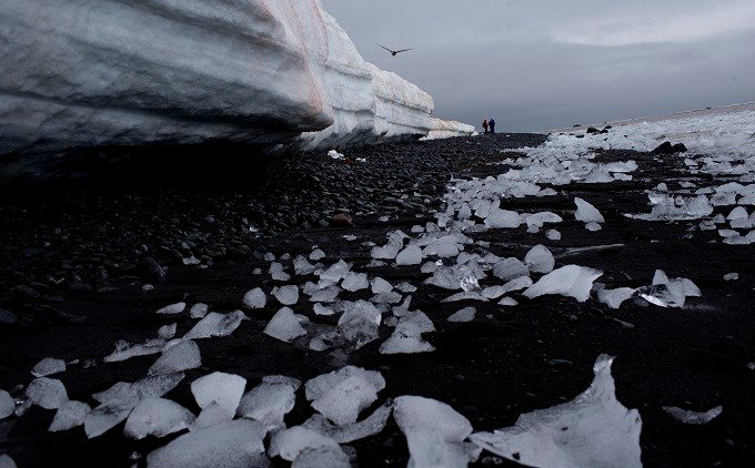 In this Jan. 26, 2015 photo, pieces of thawing ice are scattered along the beachshore at Punta Hanna, Livingston Island, in the Antarctica. The countries that decide the fate of Antarctica agreed on Friday to create the world's largest marine protected ar