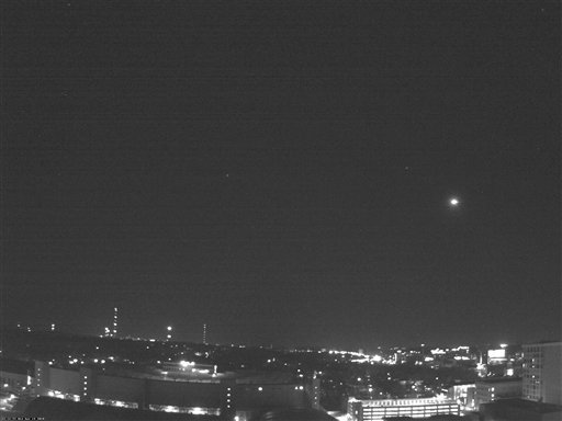 This black and white photo from a rooftop webcam released Thursday, April 15, 2010, by the University of Wisconsin-Madison Department of Atmospheric and Oceanic Sciences shows a fireball as it passed over Madison, Wis., Wednesday night.