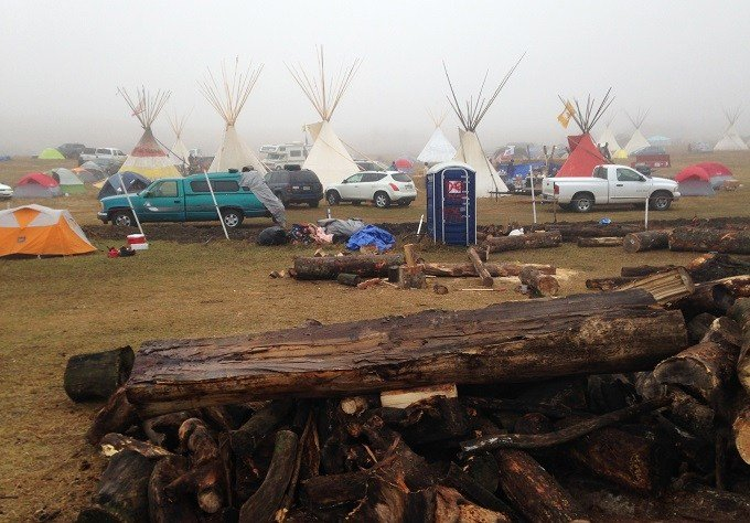 Protesters of the Dakota Access pipeline encampment sits Wednesday, Oct. 26, 2016, on private property near Cannon Ball, N.D., owned by the pipeline developer, Texas-based Energy Transfer Partners. Both the local sheriff and Energy Transfer Partners have