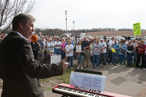 In this April 1, 2010 photo, Dave Nabity, former gubernatorial candidate and head of the Omaha Alliance for the Private Sector, speaks to the crowd at a tea party express rally in Omaha, Neb. (AP Photo/Nati Harnik)