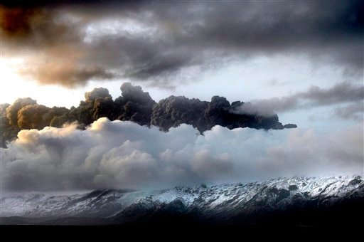 Smoke and steam hangs over the volcano under the Eyjafjallajokull glacier in Iceland, early Thursday April 15, 2010, which has erupted for the second time in less than a month. (AP Photo/Brynjar Gaudi)