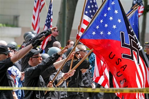 A white supremacist group salutes American flags and banners with swastikas at Los Angeles City Hall on Saturday, April 17,2010.  (AP Photo/Richard Vogel)