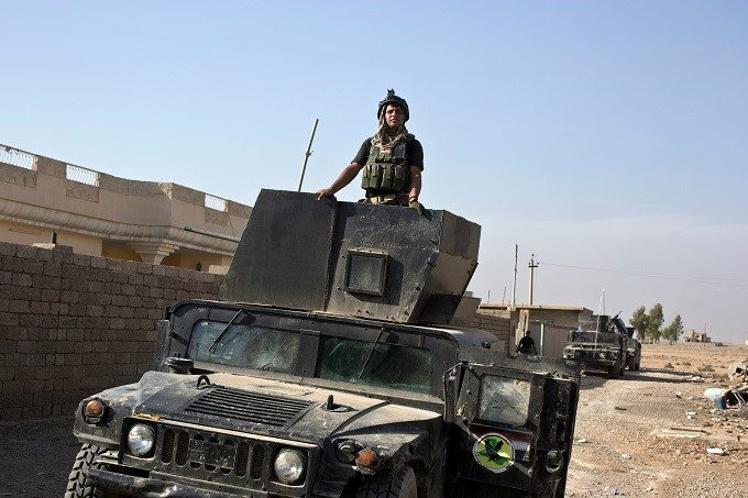 An Iraqi special forces soldier stands atop a Humvee in the village of Bazwaya, some 8 kilometers from the center of Mosul, Iraq, Monday, Oct. 31, 2016. Iraqi special forces stood poised to enter Mosul in an offensive to drive out Islamic State militants