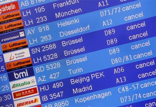 Cancelled flights are displayed on an electronic information board at the Tegel airport in Berlin Germany, Sunday, April 18, 2010.  (AP Photo/Michael Sohn)