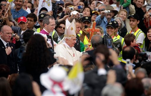 Pope Bendict XVI arrives to celebrate a mass at the Granaries in Floriana, Malta, Sunday, April 18, 2010. The pope is in Malta for a two-day visit during which he met with the president and visited a grotto linked to St. Paul. (AP Photo/Andrew Medichini)