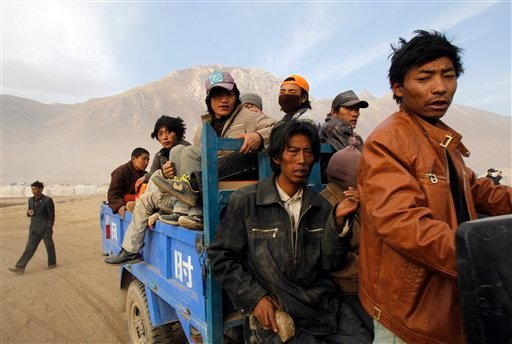 Earthquake survivors are transported to a camp set up for quake victims in earthquake-hit Yushu county, northwest China's Qinghai province, Monday, April 19, 2010. (AP Photo/Andy Wong)