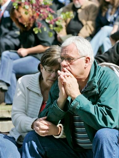 Ila Clark, left, holds her husband Dale Clark, right, of Denham Springs, La., during the reading of the names of the 168 victims of the Oklahoma City bombing.