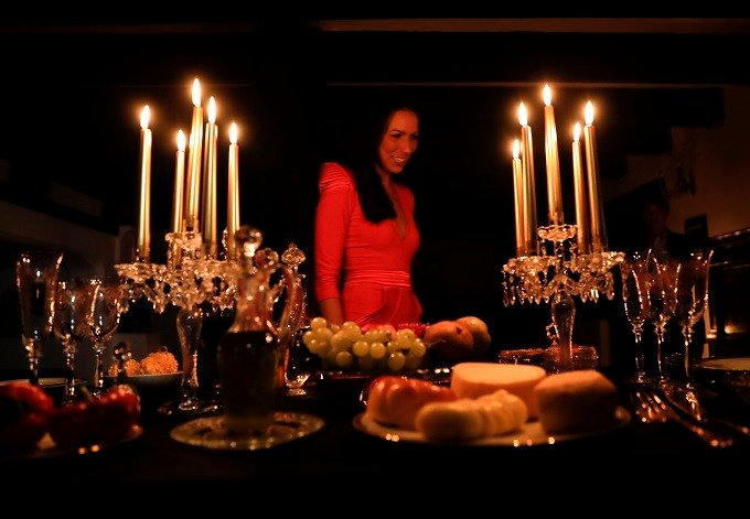 Tami Varma the granddaughter of Devendra Varma, a scholar of English gothic tales and an expert in vampire lore, looks at the dinner table set at Bran Castle in Bran, Romania, Monday, Oct. 31, 2016. A Canadian brother and sister are passing Halloween nigh