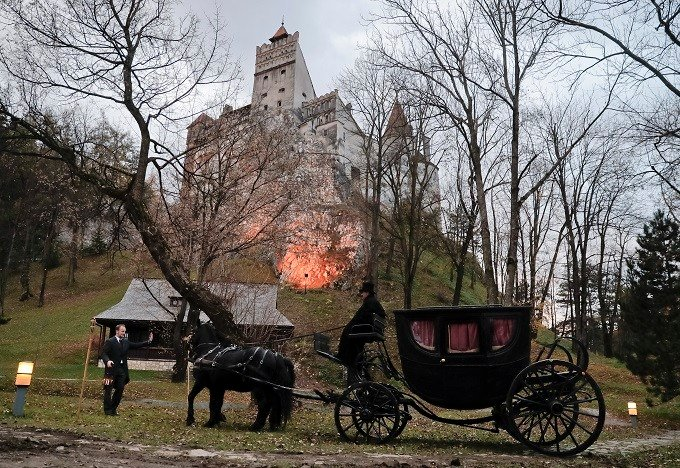 The stagecoach carrying Tami Varma and her brother Robin, the grandchildren of Devendra Varma, a scholar of English gothic tales and an expert in vampire lore, arrives at the Bran Castle in Bran, Romania, Monday, Oct. 31, 2016. A Canadian brother and sist