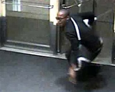 This image taken from video and released Tuesday, April 20, 2010 by the Denver police shows a suspect wanted for stealing an iPad.