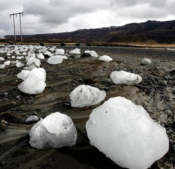 Ice chunks carried downstream by floodwaters caused by volcanic activity lie on the Markarfljot river bank Friday April 16 2010.