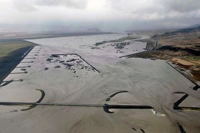 In this image made available by the Icelandic Coastguard, taken Wednesday April 14, 2010, floodwaters rising after the volcano under the Eyjafjallajokull.