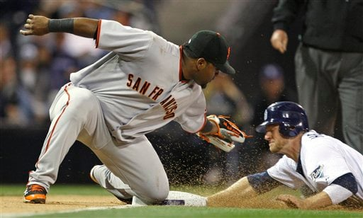 San Francisco Giants third baseman Pablo Sandoval can not make the tag on San Diego Padres' Chase Headley who steals third in the second inning of a baseball game Tuesday April 20, 2010 in San Diego. (AP Photo/Lenny Ignelzi)