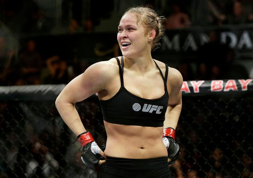 In this Feb. 22, 2014, file photo, Ronda Rousey looks around after defeating Sara McMann in a UFC 170 mixed martial arts women's bantamweight title bout in Las Vegas.
