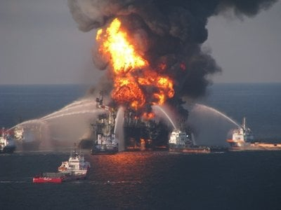 This image provided by the U.S. Coast Guard shows fire boat response crews battle the blazing remnants of the off shore oil rig Deepwater Horizon Wednesday.