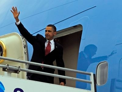 President Barack Obama waves as he boards Air Force One at Los Angeles International Airport in Los Angeles Tuesday, April 20, 2010.