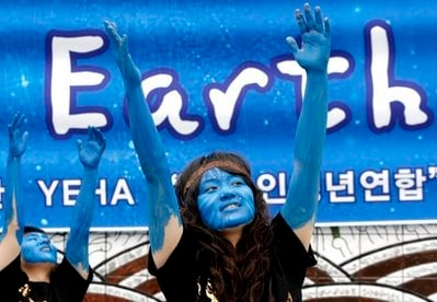 South Korean environmental activists painted as characters from James Cameron's movie 'Avatar' perform during a rally to mark the 40th anniversary of Earth.