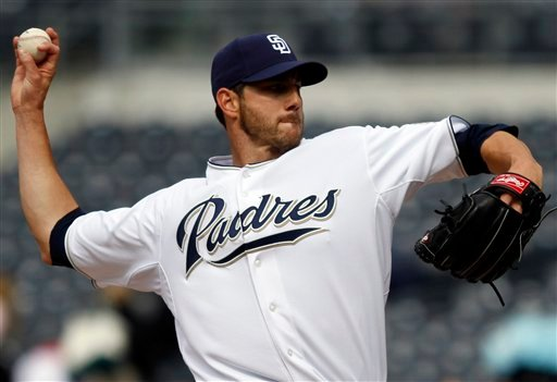 San Diego Padres starter Jon Garland pitches against the San Francisco Giants in the first inning of a baseball game Wednesday April 21, 2010, in San Diego. (AP Photo/Lenny Ignelzi)