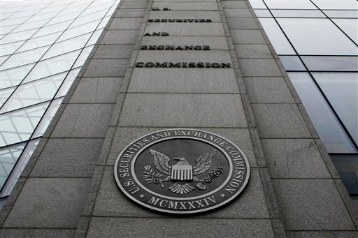 In this Dec. 17, 2008 file photo, the Securities and Exchange Commission (SEC) headquarters in Washington is shown. Senior staffers at the Securities and Exchange Commission spent hours surfing pornographic sites on government-issued computers. (AP Photo)