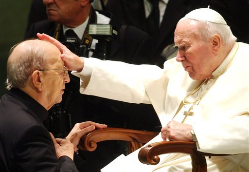 In this Nov. 30, 2004 file photo, then Pope John Paul II gives his blessing to late father Marcial Maciel, founder of Christ's Legionaries. (AP Photo/Plinio Lepri, File)