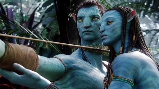"In this undated file film publicity image originally released by 20th Century Fox, the character Neytiri, voiced by Zoe Saldana, right, and the character Jake, are shown in a scene from, ""Avatar.""  (AP Photo/20th Century Fox, File)"
