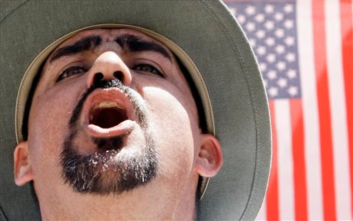 A protester shouts as he joins thousands attending an immigration rally at the Arizona Capitol on Sunday, April, 25, 2010. (AP Photo/Ross D. Franklin)