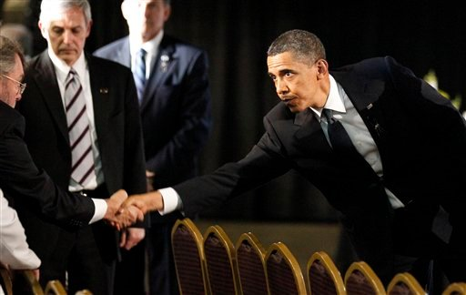 President Barack Obama, right, reaches to shake hands with a relative at a memorial service for the miners killed in the Upper Big Branch Mine, in Beckley, W.Va., Sunday, April 25, 2010.(AP Photo/Alex Brandon)