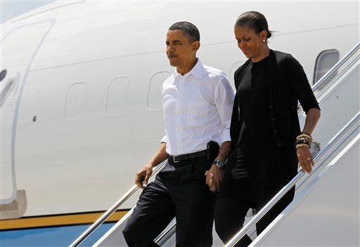 President Barack Obama and first lady Michelle Obama step off Air Force One as they arrive at the airport in Asheville, N.C., Friday, April 23, 2010.(AP Photo/Alex Brandon)