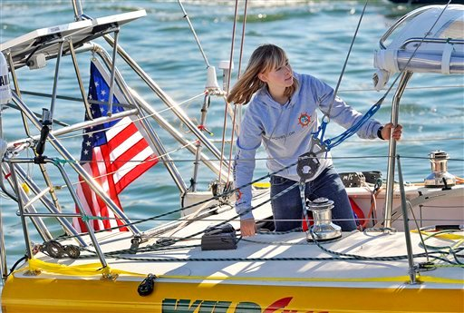 In this Jan. 23, 2010 photo, Abby Sunderland, 16, looks out from her sailboat, Wild Eyes, as she leaves for her world record attempting journey at the Del Rey Yacht Club in Marina del Rey, Calif.