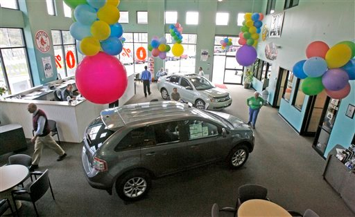 In this April 21, 2010 file photo, customers are seen in the showroom at the Formula Ford dealership in Montpelier, Vt. (AP Photo/Toby Talbot, file)