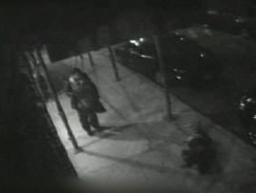 In this frame grab from an April 18, 2010 surveillance video obtained and released by ABC, is shown a pedestrian approaching a homeless man, lower right, lying on the ground after being stabbed after he assisted a woman being attacked.