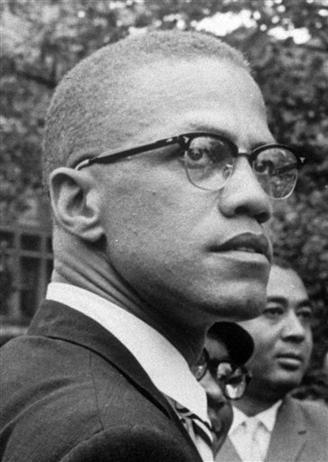 In this 1963 file photo, Black Nationalist leader Malcolm X is pictured at a rally at Lennox Avenue and 115th St., in the Harlem section of New York.