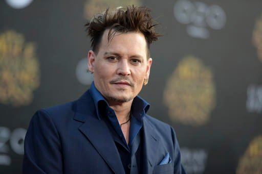 """In this May 23, 2016 file photo, Johnny Depp arrives at the premiere of """"Alice Through the Looking Glass"""" at the El Capitan Theatre, in Los Angeles."""