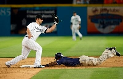 San Diego Padres' Tony Gwynn steals second base as Florida Marlins second baseman Dan Uggla attempts the tag during the eighth inning of a baseball game Tuesday, April 27, 2010 in Miami.