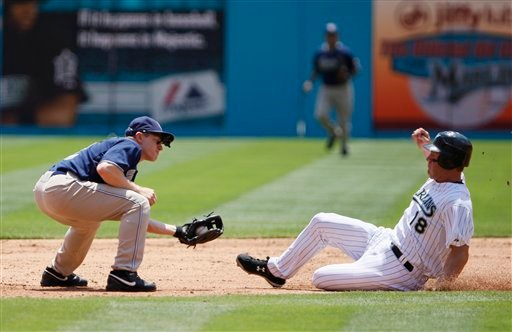 San Diego Padres second baseman David Eckstein, left, prepares to tag Florida Marlins' Wes Helms after Helms attempted to steal second during the first inning of a baseball game, Wednesday, April 28, 2010, in Miami. (AP Photo/Wilfredo Lee)